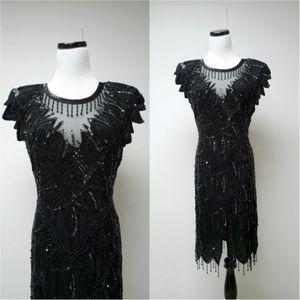 SCALA . 1920s style black silk beaded dress